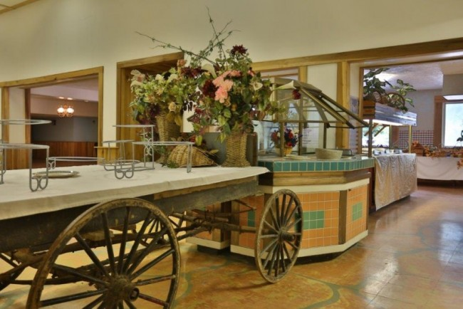 [Image: Buffet tables ready to display your reception foods.]